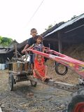 Piccoli bambini e trattori Fotografia Stock