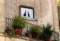Piccoli finestra e balcone Immagine Stock Libera da Diritti