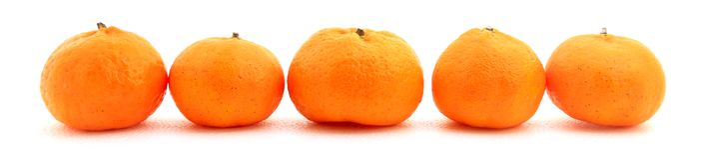 Piccoli mandarini del miele sparati sopra fondo bianco Fotografia Stock Libera da Diritti