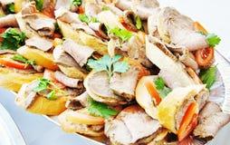 Piccoli panini con il pomodoro ed il prosciutto freschi Fotografia Stock