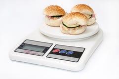 Piccoli panini dell'hamburger con il prosciutto ed il cetriolo Fotografia Stock Libera da Diritti