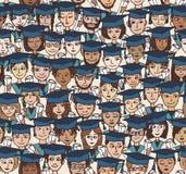 Piccoli studenti con i cappucci di graduazione Immagine Stock Libera da Diritti