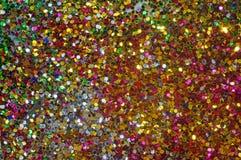 Piccoli zecchini multicolori come fondo Fotografia Stock Libera da Diritti