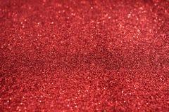 Piccoli zecchini rossi come fondo Scintillio come fondo della festa Bella priorità bassa rossa fotografia stock libera da diritti