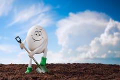 Piccolo agricoltore dell'uovo Immagini Stock