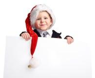 Piccolo assistente della Santa con la bandiera. Fotografia Stock