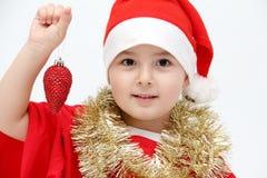 Piccolo bambino con il cappello di Santa Immagini Stock