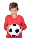 Piccolo bambino dell'allievo con la sfera di calcio Fotografie Stock