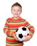 Piccolo bambino dell'allievo con la sfera di calcio Fotografia Stock Libera da Diritti