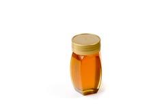 Piccolo barattolo del miele con la copertura Fotografia Stock Libera da Diritti