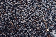 Piccolo buon di pietra basso per marrone del fondo Fotografia Stock Libera da Diritti