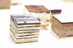 Piccolo cakecollection del cubo di varie torte Immagine Stock