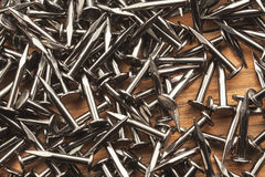 Piccolo chiodo del metallo sulla tavola Immagine Stock Libera da Diritti