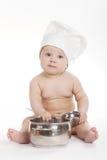 Piccolo cuoco sveglio su fondo bianco Fotografia Stock
