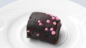 Piccolo dolce di cioccolato con le palle rosa archivi video