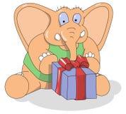 Piccolo elefante con un presente nella casella Immagini Stock