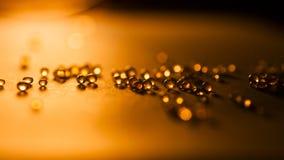 Piccolo, estratto tansparent delle palle con bokeh ed arancia immagine stock libera da diritti