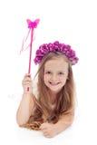 Piccolo fairy con la corona del fiore e la bacchetta di magia Immagine Stock