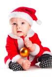 Piccolo gnome sveglio del bambino nel colore rosso con la sfera dorata Fotografie Stock