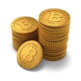 Piccolo gruppo di Bitcoins dorato inciso Fotografie Stock
