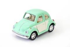 Piccolo mini modello dell'automobile isolato su fondo bianco Fotografia Stock