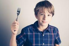 Piccolo ragazzo affamato con la forcella pronta da mangiare Immagini Stock Libere da Diritti