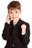 Piccolo ragazzo con un telefono mobile Immagine Stock Libera da Diritti