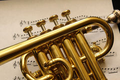 Piccolo Trumpet on Sheet Music Stock Photography
