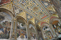 Piccolomini Library Ceiling. The beautiful Interior of the Piccolomini library in the Siena cathedral, with painted ceiling and frescoed walls stock photo