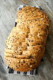 Pice of bread with seeds baker elaboration Royalty Free Stock Images
