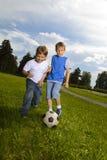 pièce de garçon dans le football Photos libres de droits