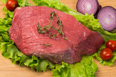Pice of fresh raw meat with vegetables Stock Photography