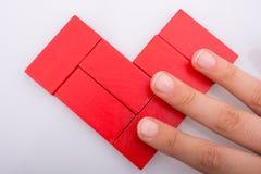 Pices coloridos do dominó que formam a forma de Sun Imagem de Stock