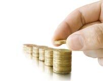 Pièces de monnaie dans la main Image libre de droits