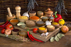 Pices and herbs in wooden bowl on wooden table Stock Image