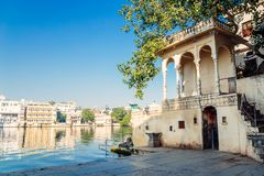 Pichola lake and old buildings at Gangaur Ghat in Udaipur, India. Pichola lake and old building at Gangaur Ghat in Udaipur, India Royalty Free Stock Image