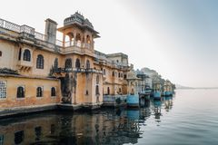 Pichola lake and old buildings at Gangaur Ghat in Udaipur, India. Pichola lake and old building at Gangaur Ghat in Udaipur, India Royalty Free Stock Photography