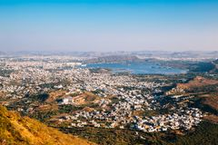 Pichola lake and old town buildings from Monsoon Palace in Udaipur, India. Pichola lake and old town from Monsoon Palace in Udaipur, India stock photography