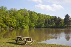 Picinic Table and Lake. A picnic table at the shore of a lake stock photos