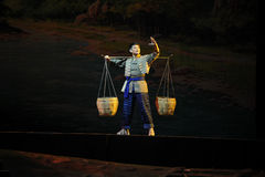 Pick a burden tramp over mountains and through ravines- Jiangxi opera a steelyard Stock Images