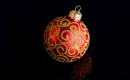 Pick decor for christmas tree. Christmas ornament single red ball on black background. Christmas ornament concept. Elegant and luxury christmas decor close up royalty free stock images