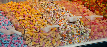 Pick and mix candies. Selection of sweet candies for sale in a pick and mix counter at a sweetshop. A popular method of selling sweets where the customer can stock photos