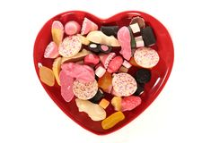 Love pick and mix sweets. Pick and mix sweets on a heart plate Stock Photos