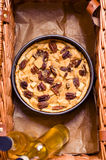 Picnic basket with pie. Picnic basket with apple and pecan nuts pie Royalty Free Stock Images