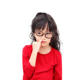 Pick a nose. Asian little girl picking a nose with bugging face isolated on white background royalty free stock image
