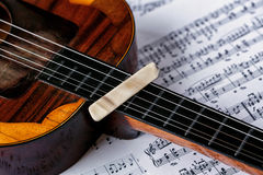 Pick on old musical instrument with strings. Tamburitza stock photo