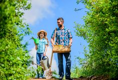 Pick out flats favorite plants. Garden works. Spring garden. Spring gardening checklist. Father and daughter with shovel stock photo