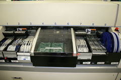 Pick and Place Machine. Loaded with reels for a couple dozen components Stock Photography
