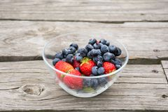 Fresh Fruits. Pick the ripe strawberries and crunchy Blueberries for healthy snack Stock Images