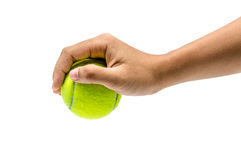 Pick a tennis ball. A hand picking a green tennis ball up Royalty Free Stock Photos